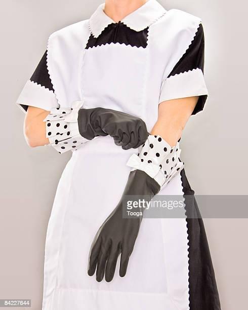 maid putting on rubber gloves - ゴム手袋 ストックフォトと画像