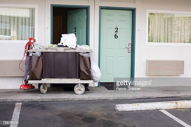 maid trolley outside a motel - motel stock photos and pictures
