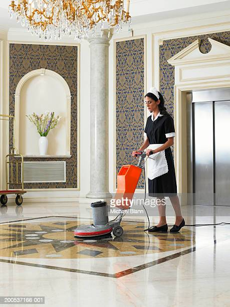 maid vacuuming hotel foyer - maid stock pictures, royalty-free photos & images
