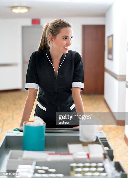 maid working at a hotel - janitorial services stock photos and pictures