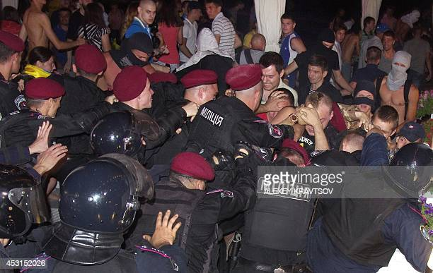 Maidan activists clash with police to prevent a concert of pop singer Ani Lorak in the southern Ukrainian city of Odessa late on August 3 2014 The...