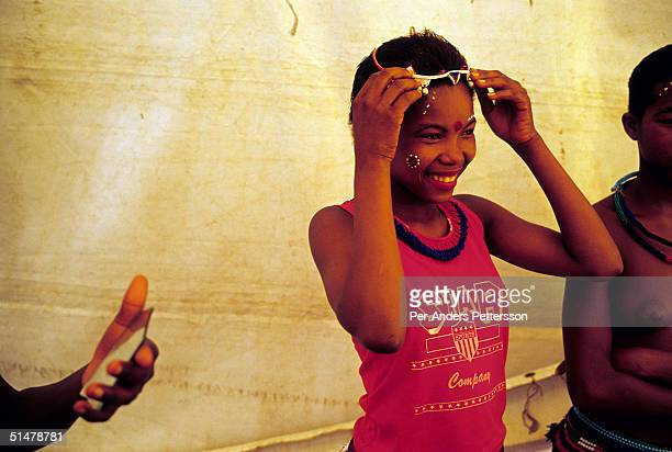 A maiden dresses and puts on makeup to prepare for the annual Reed Dance September 11 2004 in Nongoma in rural Natal South Africa About 20000 fellow...