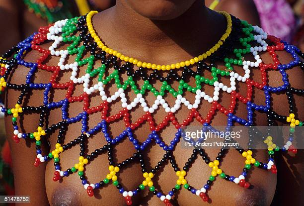 A maiden wears a traditional Zulu necklace as she prepares for the annual Reed Dance on September 11 2004 in Nongoma in rural Natal South Africa...