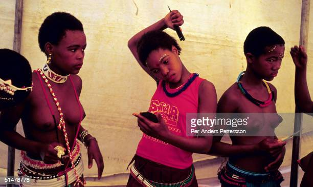 Maidens dress and put on makeup to prepare for the annual Reed Dance on September 11 2004 in Nongoma in rural Natal South Africa About 20000 fellow...