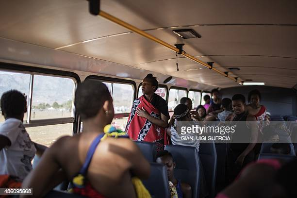 Maidens get ready in a bus on the last day of the annual royal Reed Dance at the Ludzidzini Royal palace on August 31 2015 in Lobamba Swaziland...