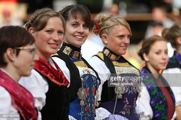Maids of honor line up after the Alpine Wrestling Festival BruenigSchwinget at the top of the Bruenig Pass on July 27 2014 in Meiringen Switzerland