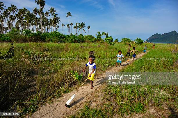 CONTENT] Maiga Island Sabah October 2013 The kids of Maiga Island some 2 hours away from Mabul Island Sabah plays with their homemade toy These kids...