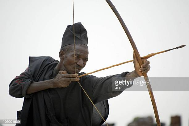 Maigari Mainasara forty eightyearold hunter and farmer pulls back his arrow trying to target the bull eye with his bow Wednesday 17 March 2004 at the...