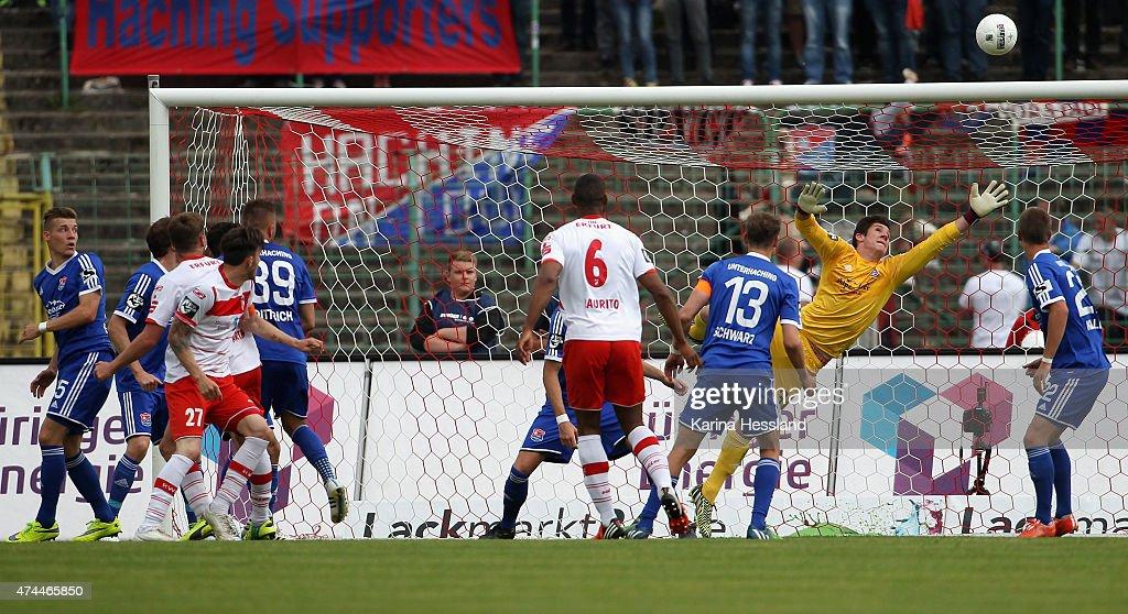 Maik Baumgarten of Erfurt scores the opening goal, Goalkeeper Yannik Oettl of Unterhaching without a chance during the Third League match between FC Rot Weiss Erfurt and SpVgg Unterhaching at Steigerwaldstadion on May 23, 2015 in Erfurt, Germany.