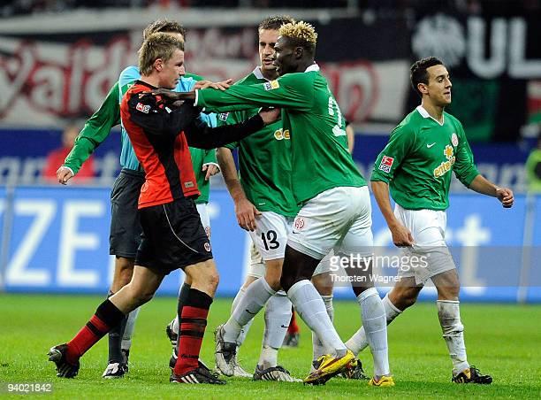 Maik Franz of Frankfurt in action with Aristide Bance of Mainz during the Bundesliga match between Eintracht Frankfurt and FSV Mainz 05 at...