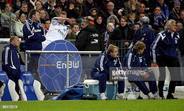 Maik Franz of Karlsruhe kicks a chair after referee Herbert Fandel has shown him the red card during the Bundesliga match between Karlsruher SC and...