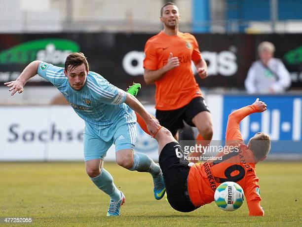 Maik Kegel of Chemnitz challenges Andre Mandt of Saarbruecken during the third Liga match between Chemnitzer FC and 1FC Saarbruecken at Stadium an...