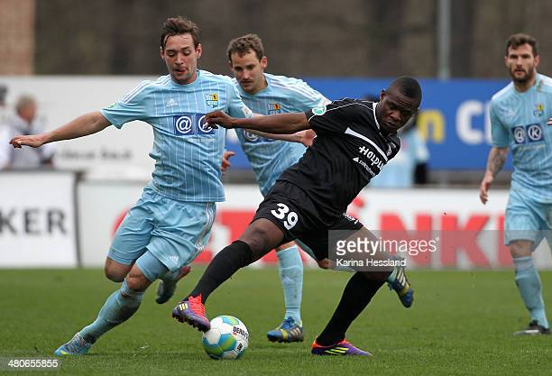 Maik Kegel of Chemnitz challenges Francky Sembolo of Halle during the third Liga match between Chemnitzer FC and Hallescher FC at Stadion an der...