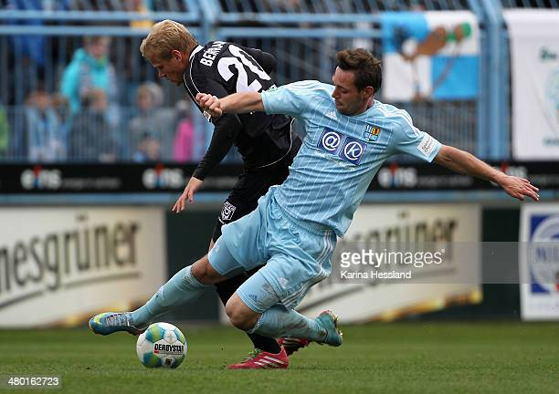 Maik Kegel of Chemnitz challenges Soeren Bertram of Halle during the third Liga match between Chemnitzer FC and Hallescher FC at Stadion an der...