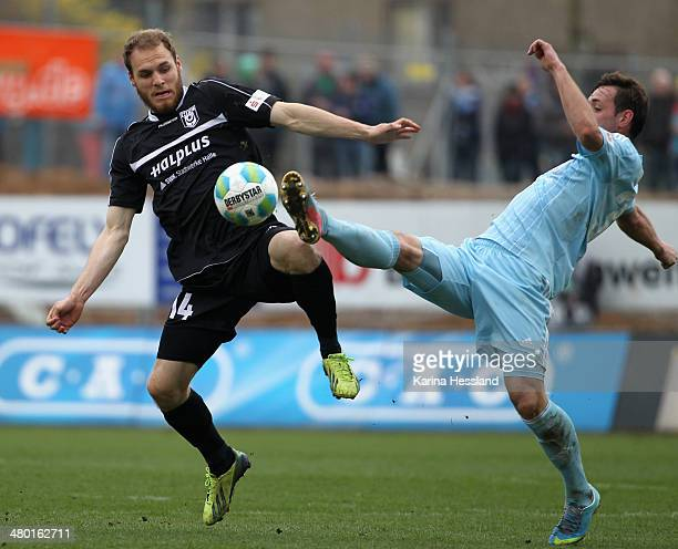 Maik Kegel of Chemnitz challenges Timo Furuholm of Halle during the third Liga match between Chemnitzer FC and Hallescher FC at Stadion an der...
