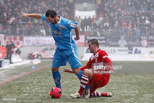 Maik Kegel of Chemnitz is challenged by Anton Mueller of Halle during the Third League match between Hallescher FC and Chemnitzer FC at Erdgas...