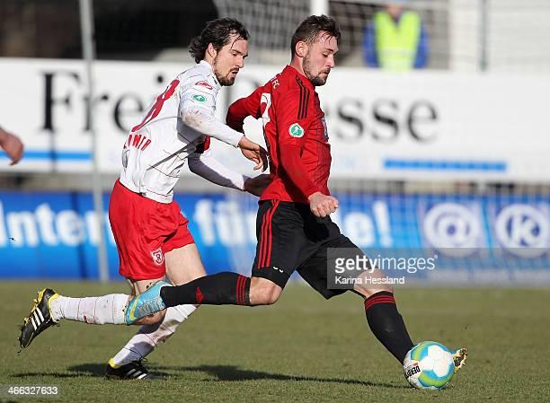 Maik Kegel of Chemnitz is challenged by Sebastian Nachreiner of Regensburg during the 3rd Liga match between Chemnitz and Regensburg at Stadion an...
