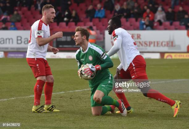 Maik Kegel of Cologne and Bernard Kyere support their goalkeeper Tim Boss during the 3 Liga match between SC Fortuna Koeln and SV Wehen Wiesbaden at...