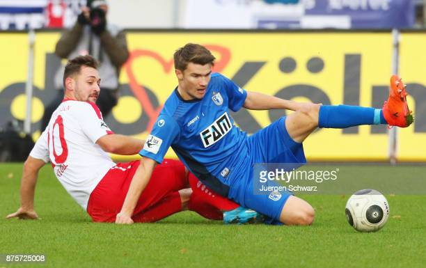 Maik Kegel of Cologne and Bjoern Rother of Magdeburg fight for the during the 3 Liga match between SC Fortuna Koeln and 1 FC Magdeburg at Suedstadion...
