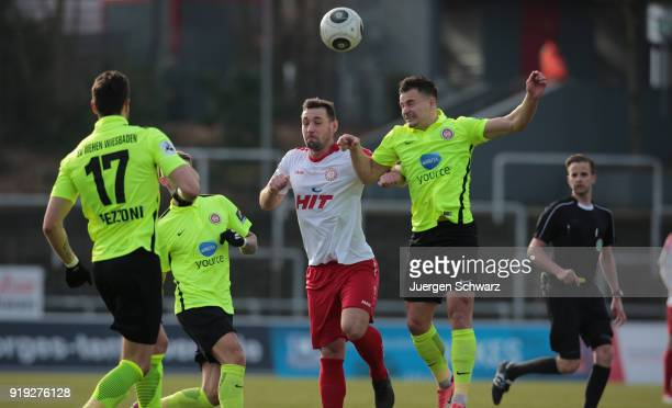 Maik Kegel of Cologne and Sebastian Mrowca of Wiesbaden jump for a header during the 3 Liga match between SC Fortuna Koeln and SV Wehen Wiesbaden at...