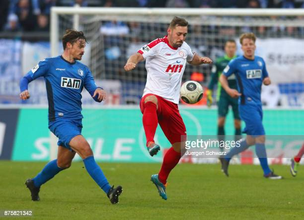 Maik Kegel of Cologne controls the ball beside Dennis Erdmann of Magdeburg during the 3 Liga match between SC Fortuna Koeln and 1 FC Magdeburg at...