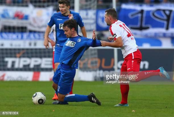 Maik Kegel of Cologne tackles Dennis Erdmann of Magdeburg during the 3 Liga match between SC Fortuna Koeln and 1 FC Magdeburg at Suedstadion on...