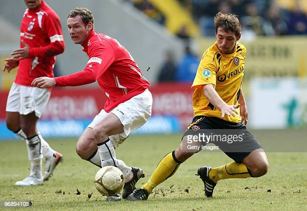 Maik Kegel of Dynamo Dresden and Dennis Hillebrand of Rot Weiss Erfurt battle for the ball during the 3 Liga match between Dynamo Dresden and Rot...