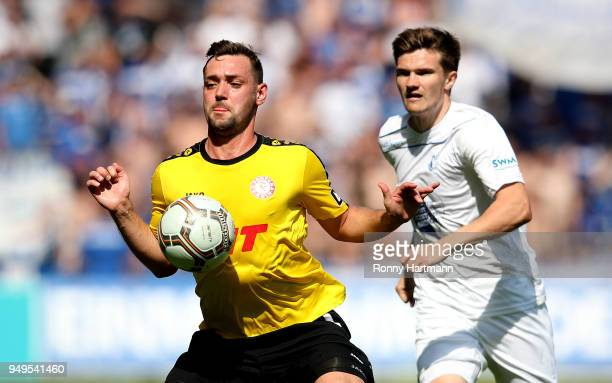 Maik Kegel of Fortuna Koeln and Bjoern Rother of 1 FC Magdeburg compete during the 3 Liga match between 1 FC Magdeburg and SC Fortuna Koeln at...