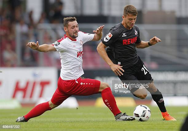 Maik Kegel of Fortuna Koeln and Salih Oezcan of FC Koeln battle for the ball during the preseason friendly match between Fortuna Koeln and 1 FC Koeln...