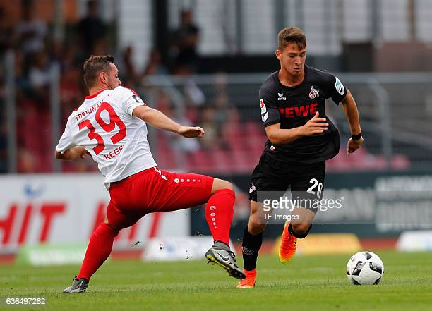 Maik Kegel of Fortuna Koeln and Salih Oezcan of FC Koeln battle for the ball during the preseason friendly match between Fortuna Koeln and 1 FC Koeln...