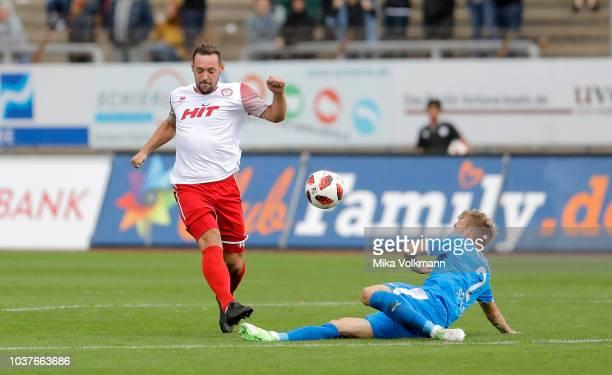 Maik Kegel of Fortuna Koeln challenges Michael Schulze of Lotte during the 3 Liga match between SC Fortuna Koeln and VfL Sportfreunde Lotte at...