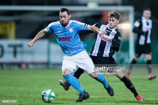 Maik Kegel of Fortuna Koeln is challenged by Lukas Laemmel of Aalen during the 3 Liga match between VfR Aalen and SC Fortuna Koeln at Ostalb Stadion...