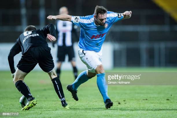 Maik Kegel of Fortuna Koeln is challenged by Rico Preissinger of Aalen during the 3 Liga match between VfR Aalen and SC Fortuna Koeln at Ostalb...