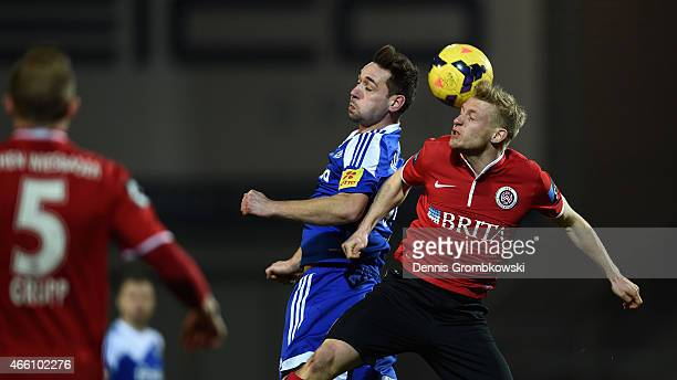 Maik Kegel of Holstein Kiel and Patrick Funk of SV WehenWiesbaden go up for a header during the 3 Liga match between SV WehenWiesbaden and Holstein...