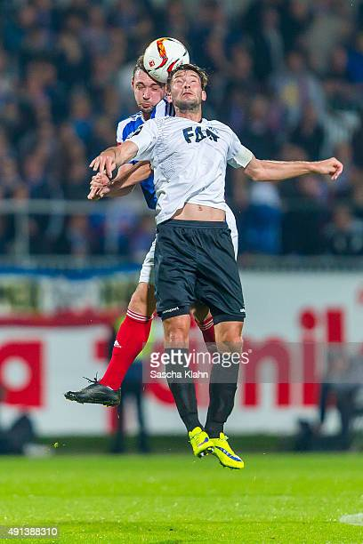 Maik Kegel of Holstein Kiel challenges Marius Sowislo of 1 FC Magdeburg during the 3 League match between Holstein Kiel and 1 FC Magdeburg at...
