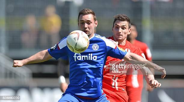 Maik Kegel of Kiel and Adam Jabiri of Wuerzburg compete for the ball during the Third League match between Wuerzburger Kickers and Holstein Kiel at...