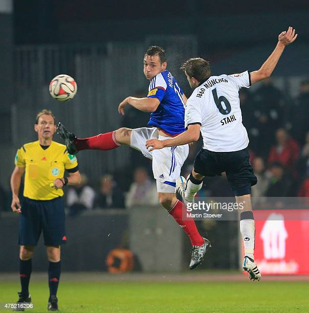 Maik Kegel of Kiel challenges Dominik Stahl of Muenchen during the match between Holstein Kiel and 1860 Muenchen at Holsten Stadion on May 29 2015 in...