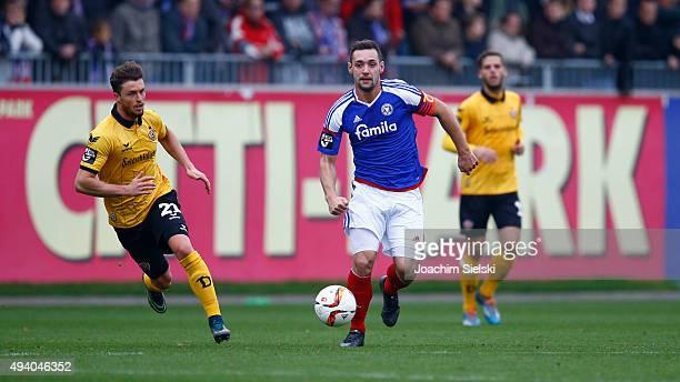 Maik Kegel of Kiel challenges Quirin Moll of Dresden during the Third League match between Holstein Kiel and Dynamo Dresden at HolsteinStadion on...