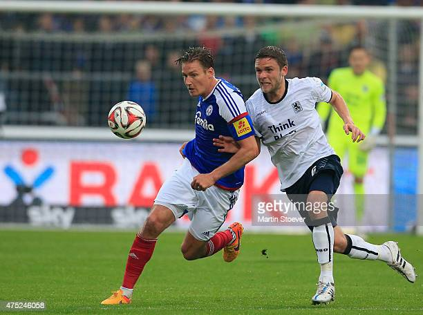 Maik Kegel of Kiel plays the ball during the match between Holstein Kiel and 1860 Muenchen at Holsten Stadion on May 29 2015 in Kiel Germany