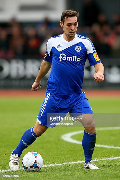 Maik Kegel of Kiel runs with the ball during the third League match between Fortuna Koeln and Holstein Kiel at Suedstadion on November 9 2014 in...