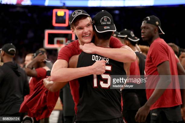 Maik Kotsar and PJ Dozier of the South Carolina Gamecocks celebrate after defeating the Florida Gators with a score of 77 to 70 to win the 2017 NCAA...