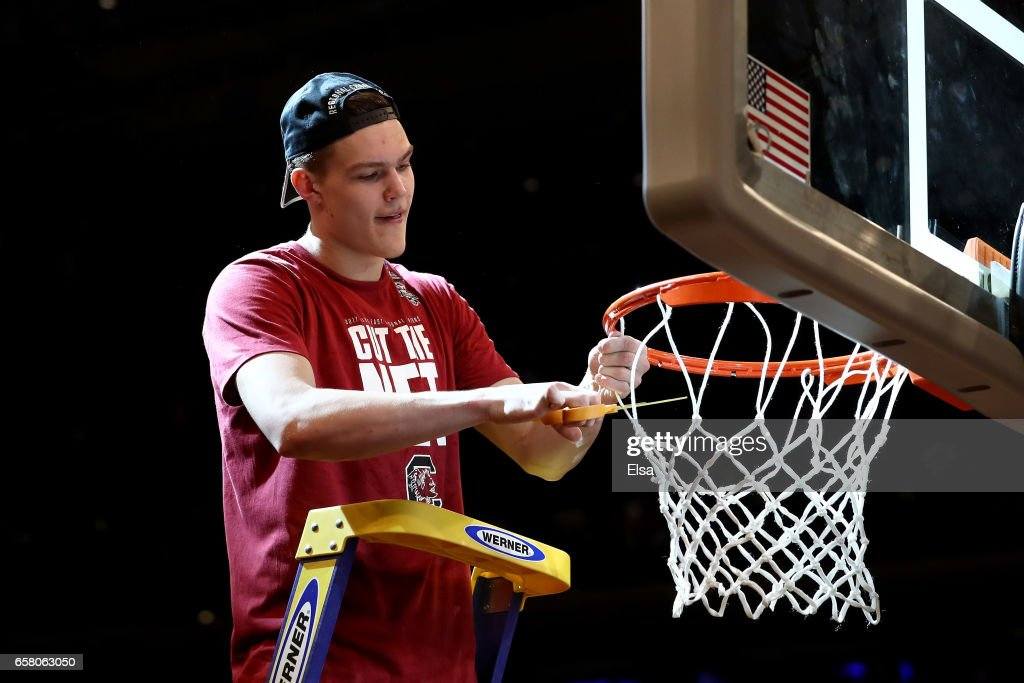 Maik Kotsar #21 of the South Carolina Gamecocks celebrates by cutting down the net after defeating the Florida Gators with a score of 77 to 70 to win the 2017 NCAA Men's Basketball Tournament East Regional at Madison Square Garden on March 26, 2017 in New York City.