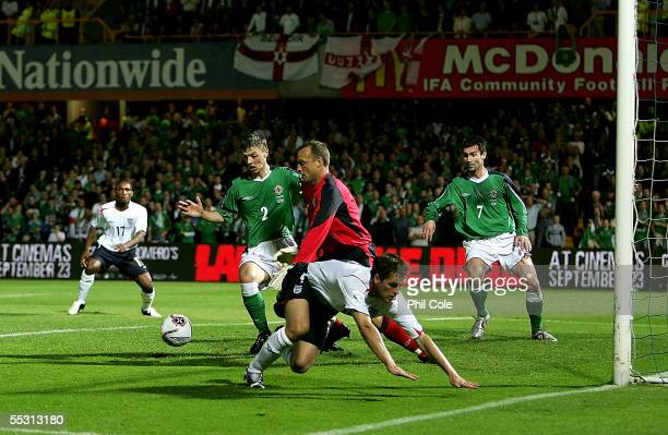 Maik Taylor of Northern Ireland battles with Michael Owen of England during the World Cup Qualifier Group six match at Windsor Park on September 7...