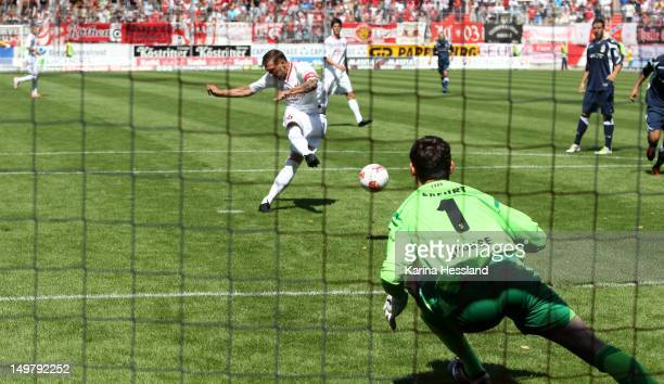 Maik Wagefeld of Halle scores from the penalty spot against goalkeeper Andreas Sponsel of Erfurt during the 3Liga match between Hallescher FC and RW...