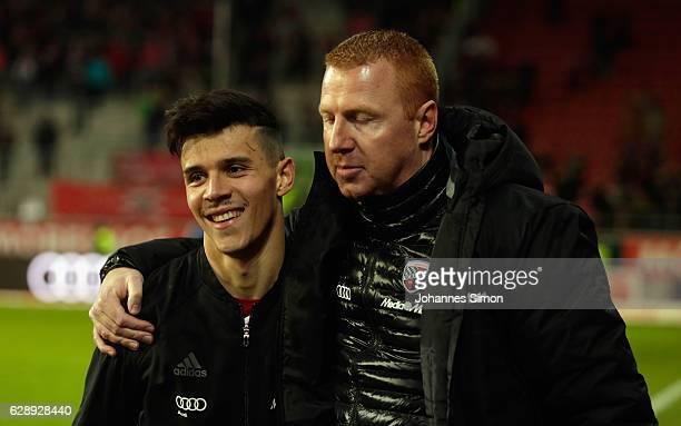 Maik Walpurgis head coach of Ingolstadt and Alfredo Morales celebrate after the Bundesliga match between FC Ingolstadt 04 and RB Leipzig at Audi...