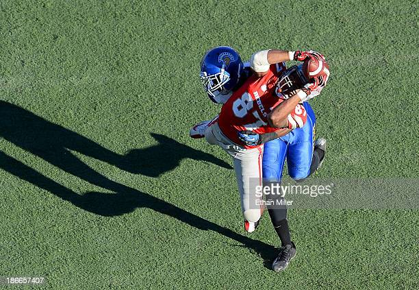 Maika Mataele of the UNLV Rebels catches a pass as Jimmy Pruitt of the San Jose State Spartans defends during the fourth quarter of their game at Sam...