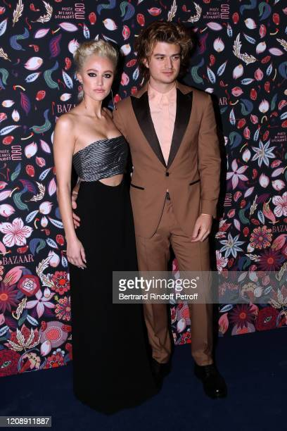 Maika Monroe and Joe Keery attend the Harper's Bazaar Exhibition as part of the Paris Fashion Week Womenswear Fall/Winter 2020/2021 At Musee Des Arts...