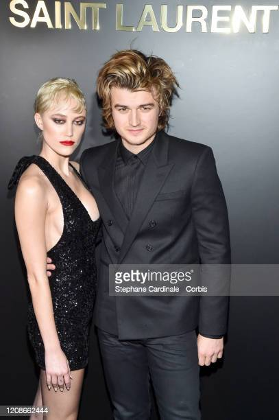 Maika Monroe and Joe Keery attend the Saint Laurent show as part of the Paris Fashion Week Womenswear Fall/Winter 2020/2021 on February 25 2020 in...