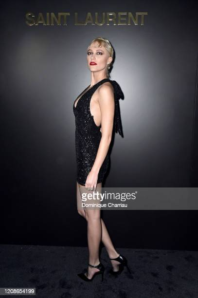 Maika Monroe attends the Saint Laurent show as part of the Paris Fashion Week Womenswear Fall/Winter 2020/2021 on February 25 2020 in Paris France