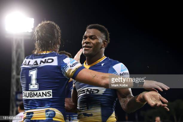 Maika Sivo of the Eels celebrates with Clinton Gutherson of the Eels after scoring a try during the round seven NRL match between the Parramatta Eels...
